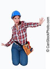Female laborer doing sign with her hand