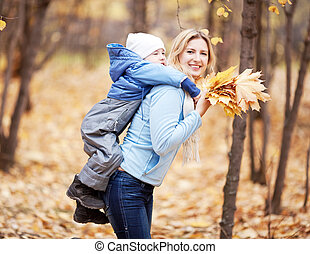 mother and son - happy young mother and her son spending...