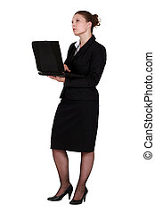 A pensive businesswoman with a laptop