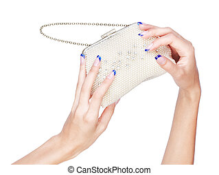 hands with clutch - isolated body part shot of beautiful...