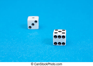 Closeup photo of white standard dices - Closeup photo of...