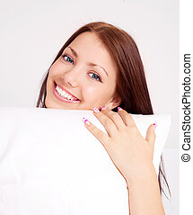 girl with a pillow - happy beautiful brunette girl holding a...
