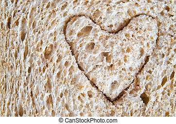 Wholemeal Bread Heart Cutout - Close up (macro) of wholemeal...