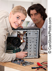 Couple attempting to repair computer