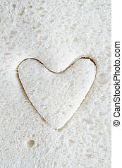White Bread Heart - Close up (macro) of white bread with a...