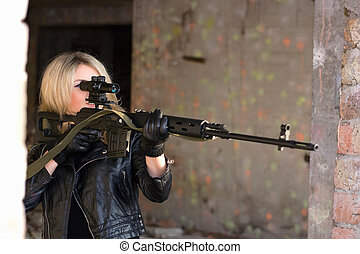 young woman with a sniper rifle - Portrait of young woman...