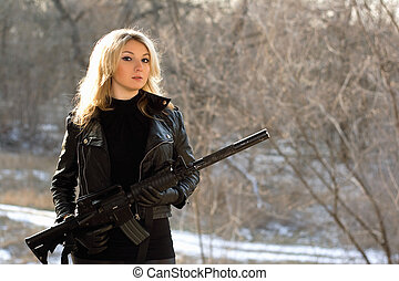 attractive young blonde with a gun