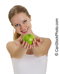 beautiful young woman holding a ripe apple isolated