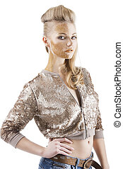 Blond beautiful creature with sequin jacket and creative make up making and hair stylish, she is turned of three quarters, looks in to the lens and has the right hand on her hip