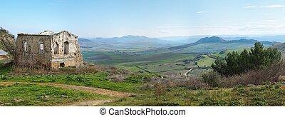 Rural landscape with farmhouse ruin
