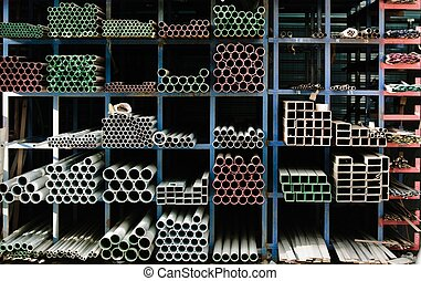 Pipes stacked up in a factory - Pipes stacked up in a...