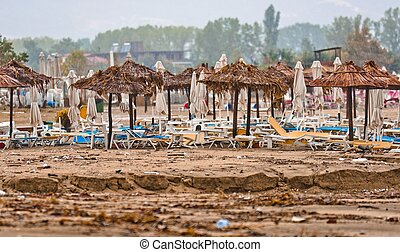 A dirty polluted beach  in the rain