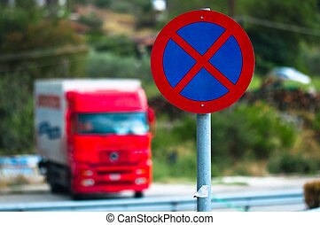 Traffic sign with car in the background