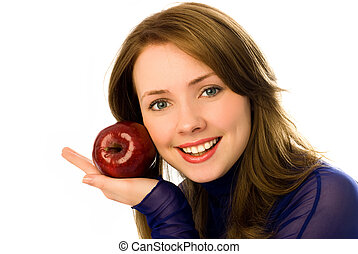 beautiful young woman with an apple isolated against white...
