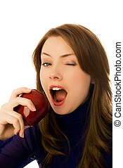 beautiful woman eats and apple and winks - beautiful young...