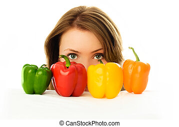 pretty girl with peppers isolated against white background