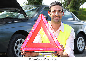 portrait of a man with safety triangle