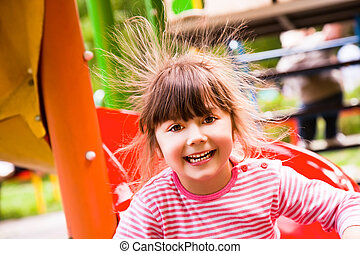 happy girl static electricity - Sweet little girl on...