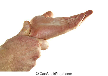 Self Massaging Wrist - The left hand of an adult male is...