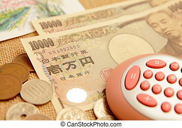 japanese yen ten thousand money with calculator and burlap...