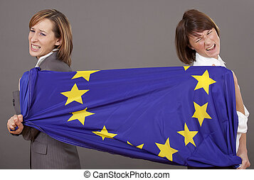 women pulling on european flag