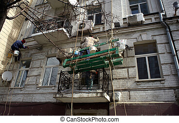 Construction workers on scaffold - Photo of Construction...