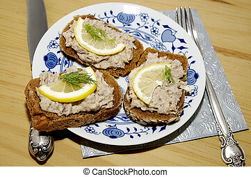 three sandwiches with pate and slices of lemon