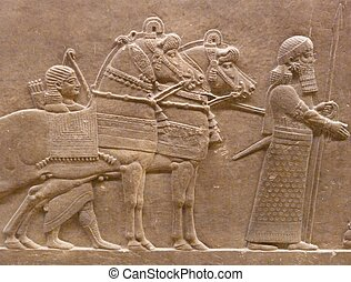Ancient Assyrian wall carvings of men and horses