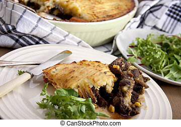 Meat pie. - A delicious home made meat pie on a wooden table...