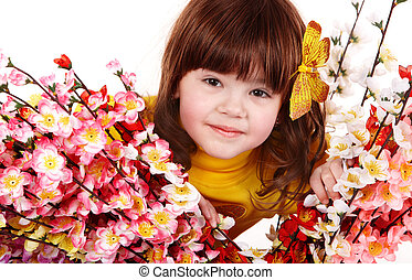 Beautiful girl with spring flower and butterfly.