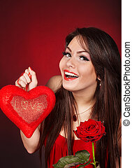 Girl with heart and flower rose on red background Valentines...