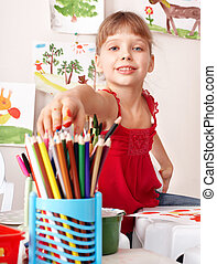 Child drawing colour pencil in preschool. Childcare/