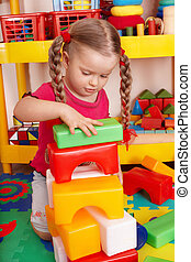 Child plaing block and construction set in preschool. -...
