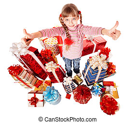 Happy child girl with group gift box thumb up. Isolated.