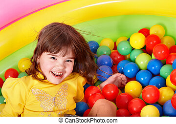 Happy child in group colourful ball - Happy little girl in...