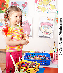 Child with colour pencil in play room. - Child preschooler...