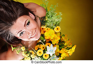 Girl holding spring flower - Young woman holding spring...