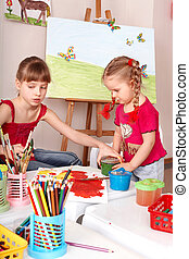 Kids drawing color pencil in play room. - Children drawing...