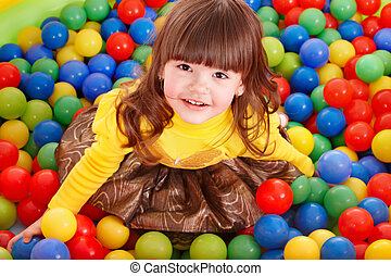 Child in group colourful ball. - Happy little girl in group...