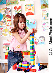 Child preschooler play construction set. - Child preschooler...