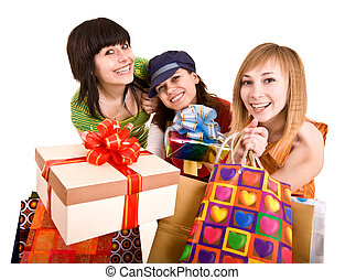 Three beautifu girlfriends enjoy shopping. Isolated.