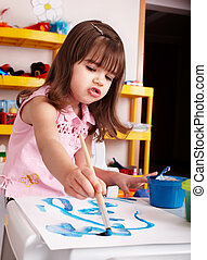 Child paint picture in preschool Child care