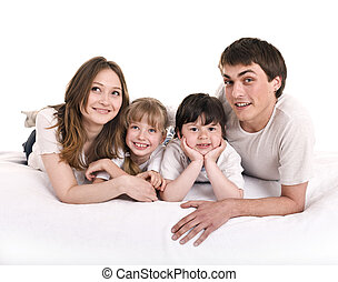 Happy family: mother, father, daughter, son.