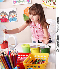Child paint picture in preschool. - Little girl paint...