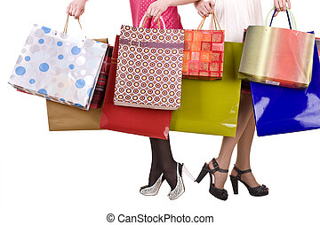Shopping bag and group of leg in shoes.