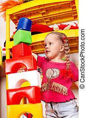Child play block and construction set in playroom.