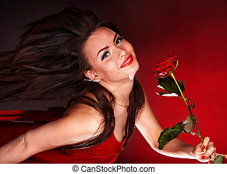 Young woman with red rose flower.
