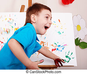 Child with easel draw  hands.  Preschool.