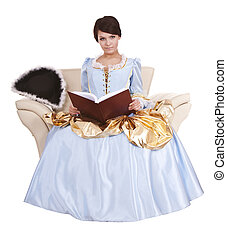 Girl in blue long dress with book on chairIsolated