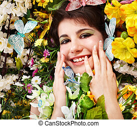 Beautiful girl with butterfly and flower on grass.